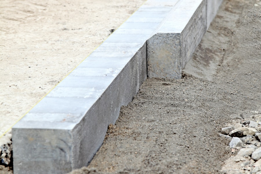 Road kerbs positioned and ready to be laid on newly constructed road in Swansea city centre